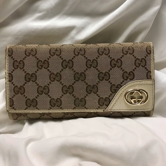 Gucci Handbags - Gucci GG Canvas Trifold Tan Wallet 181595 0959